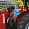 Rowley: Matthew Bodi, 3, checks out a Ferguson tractor at Vehicle Night at the Pine Grove School. The event sponsered by the Rowley Library allowed kids to climb in and see up close a variety of vehicle including an 18 wheeler, a cement truck, a bucket truck, a fire truck and many more. Jim Vaiknoras/staff photo