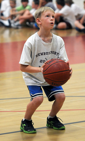 Salisbury: Jack Fehlner, 8, line up his free throw at the Newburyport boys basketball camp competition day at the Nock Middle School Friday. Jim Vaiknoras/staff photo