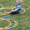 Newburyport: Axl Wedhammas, 15 months, plays with Hula-Hoops at Yankee Homecoming's Old-Fashioned Sunday on the Bartlet Mall. Jim Vaiknoras/staff photo