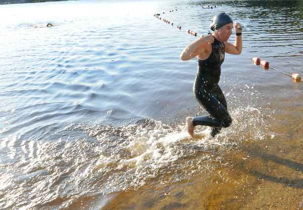 Amesbury: Monica Berube comes out of the water as she trains in Lake Gardner for Saturday's triathlon which will be her first. Jim Vaiknoras/staff photo