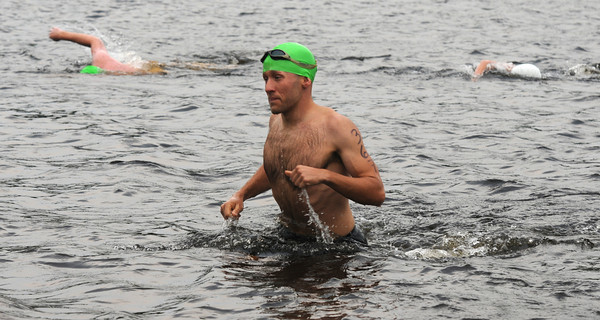 Amesbury:Chris Wawrousek come out of the water at the Dam Triathlon Saturday at Lake Gardner in Amesbury. Jim Vaiknoras/staff photo