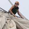 Newburyport:Bounty crew member Haley Grimes furles the sail on the main yard of the foremast as the ship sits along the Newburyport waterfront. Jim Vaiknoras/staff photo