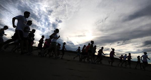 Salisbury Beach: Runners take off as the sun goes down in the  Fuel Training 5K Beach Run/Walk on Salisbury Beach Friday night. Jim Vaiknoras/staff photo