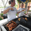 Newburyport: Nicole McDonough and Nicole Azamor work the grill selling Hot Dogs at Shirley's cart on Inn Street in Newburyport. Jim Vaiknoras/staff photo