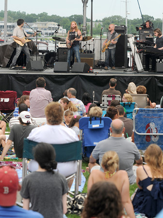 Newburyport:  The Brew performs at the 11th annual Riverfront Festival at Market Landing Park in Newburyport Saturday. Jim Vaiknoras/staff photo