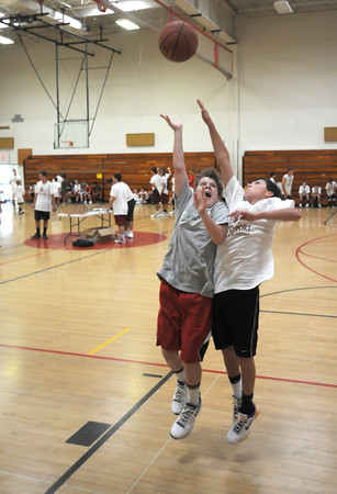 Salisbury: Nick Cummings shoots over Evan Mulvey during the 1 on 1 gamesat the Newburyport boys basketball camp competition day at the Nock Middle School Friday. Jim Vaiknoras/staff photo