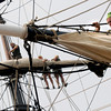 Newburyport:Bounty crew member Doug Farnt furles the sail on the main yard of the foremast as other crew members furl the sail on the top yard of the main mast as the ship sits along the Newburyport waterfront. Jim Vaiknoras/staff photo