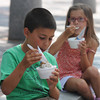 Newburyport: Matthew Deluca, 7, of Methuen and his sister Jillian, 6, enjoy ice cream in the shade on Inn Street in Newburyport Sunday morning.Jim Vaiknoras/staff photo