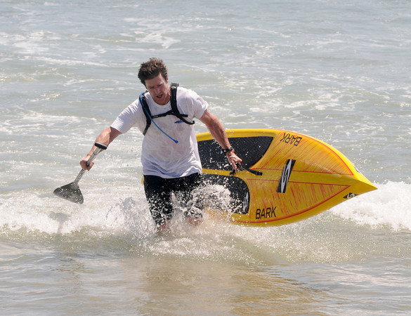 salisbury: Patrick Broemmel wins the first race at the 2nd annual Atlantic Paddle Battle Race Series on Salisbury Beach Saturday morning. Jim Vaiknoras/staff photo