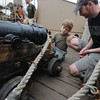 Newburyport:Cedar Schumacher , 5, and his dad David look at one of the canons, this one named Brando, on the HMS Bounty which was docked along the Newburyport waterfront this weekend. Jim Vaiknoras/staff photo