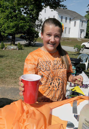 Amesbury: Lillie Bibeau, 14 sells   lemonaid on Elm Street. Lillie along with many others sold drinks and snack on in Amesbury and Salsibury Saturday to raise money for Lucy's Love Bus. The charity, names for Lucy Grogan  eases the suffering of pediatric cancer patients by providing free integrative therapies such as massage, acupuncture, and therapeutic horseback riding to children with cancer and children coping with late effects of cancer treatment. Jim Vaiknoras/staff photo