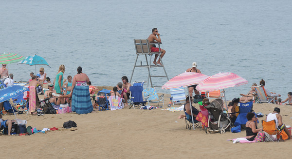 Salisbury: A Salisbury life guard watches over beach goers and swimmers on the beach Thursday afternoon. Jim Vaiknoras/staff photo