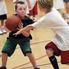 Salisbury: Finn Sullivan,8, fights for the ball with Jack Speicher,8,  during the 1 on 1 game at the Newburyport boys basketball camp competition day at the Nock Middle School Friday. Jim Vaiknoras/staff photo