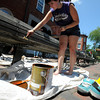 Newburyport: City employee Paige Hall stains one of the benches in Market SSquare in newburyport Sunday afternoon. Jim Vaiknoras/staff photo