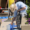 "salisbury: Robert Guillemin AKA ""Sidewalk Sam"" begins a sidewalk painting at the Sand and Sea Festival on Salisbury Beach saturday. Jim Vaiknoras/staff photo"