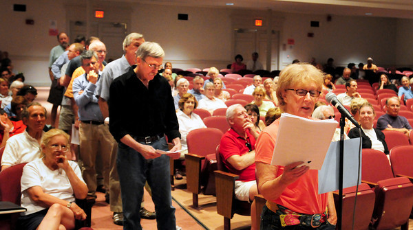 Newburyport: Leslie Eckholdt speaks in favor of the proposed Local Historical District as others wait to voice their opinion on the controversial subject last night at Newburyport High School. Bryan Eaton/Staff Photo