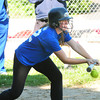 Newburyport: Newburyport High softball player Victoria Allman bunts during practice yesterday as the team prepares for their game tonight in Lowell. Bryan Eaton/Staff Photo