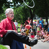 Amesbury: Magician BJ Hickman kicks off the rope that a member of the audience tied his hands with and he escaped from under a cloth. He was at Amesbury Days' Kids Day in the Park. Bryan Eaton/Staff Photo
