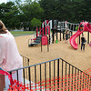 Amesbury: Organizers of the rebuilt playground at Amesbury Town Park cut a ribbon on Thurday as children played on some equipment. The ribbon-cutting coincided with Kids Day in the Park. Bryan Eaton/Staff Photo