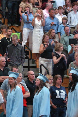 Byfield: Cameras were aimed at Triton graduating seniors as they marched into the gymnasium Saturday morning. Bryan Eaton/Staff Photo