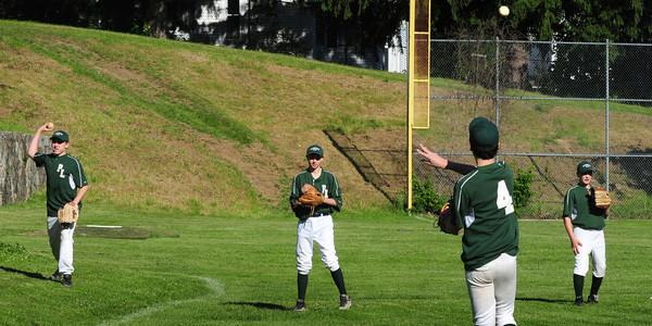 Newburyport: The Newburyport Five team warms up yesterday at the Lower Field. Bryan Eaton/Staff Photo