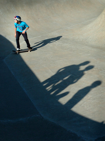 Newburyport: Cooper Ackley, 14, makes some moves at the fundraiser Skate Fest at the Newburyport Skateboard Park as others casting shadows await their turns. Cooper now lives in Dedham, Maine but formerly was from West Newbury. Bryan Eaton/Staff Photo