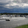 Salisbury: Dark clouds rollover the Merrimack River in a view from Ring's Island in Salisbury yesterday as unsettled weather dominated the first part of the week. The weekend is forecast to be sunnier and much warmer, possibly hitting 90 degrees. Bryan Eaton/Staff Photo