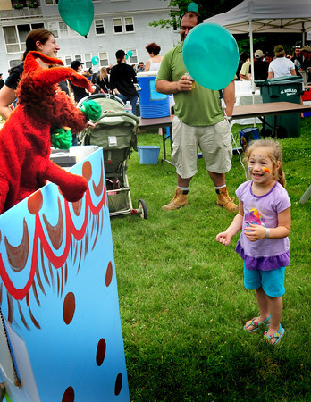 """Amesbury: Julia Serban, 4, of Amesbury gets a laugh from the """"troll under the bridge"""" during a puppet show by Nancy Sander sponsored by the Merrimack Valley Animal Hospital. The show was one of several for children at the Amesbury Days Block Party last night in the downtown. Bryan Eaton/Staff Photo"""