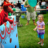 "Amesbury: Julia Serban, 4, of Amesbury gets a laugh from the ""troll under the bridge"" during a puppet show by Nancy Sander sponsored by the Merrimack Valley Animal Hospital. The show was one of several for children at the Amesbury Days Block Party last night in the downtown. Bryan Eaton/Staff Photo"