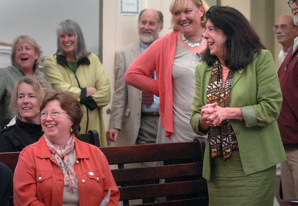 Newburyport: Newburyport Council of Aging Director, Roseanne Robillard, seated, left, and Mayor Donna Holaday, right, react to positive news about the ballots cast for the Senior Community Center. Bryan Eaton/Staff Photo