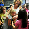 Amesbury: Amesbury Elementary School teacher Suzanne Morin gets hugs from her students as they leave for summer vacation yesterday morning. Amesbury is last area school to end the year. Bryan Eaton/Staff Photo