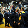 Byfield: Triton graduates toss their caps into the air at the end of ceremonies Saturday in Byfield. Bryan Eaton/Staff Photo