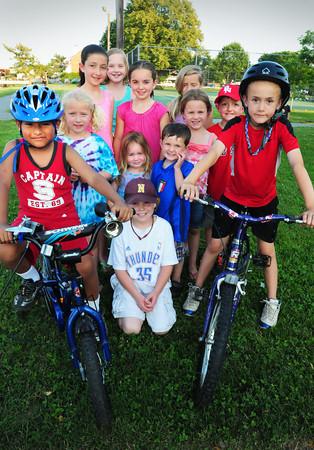 Newburyport: Rudy McQuaid, 6, left, and Tarek El Ouilani, 7, right and their friends will be biking for charity tomorrow. Bryan Eaton/Staff Photo