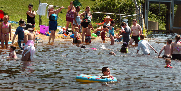 Amesbury: Lake Gardner Beach in Amesbury was crowded, though not surprisingly, as the forecast was for 90 degree-plus weather. The heat continues today, the first full day of summer, with some cooling and possible showers for the weekend. Bryan Eaton/Staff Photo