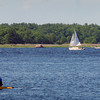 Newburyport: With Salisbury in the backdrop a kayaker, sailboat and motorboat head up the Merrimack River in a view taken from Water Street in Newburyport. Bryan Eaton/Staff Photo