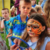 Amesbury: Daniela Beauvais, 10, of Orange checks out her tiger face painting by Renee Schneider of Colorful Kids, as next in line Ryan Collins, 7, of Amesbury checks it out as well at Amesbury Days Block Party last night. Beauvais was in town with her parents visiting her grandmother. Bryan Eaton/Staff Photo