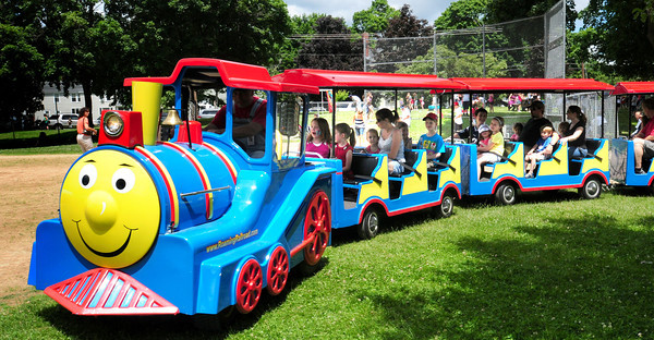 Amesbury: Children get a ride on the Roaming Railroad on Thursday at Amesbury Days' Kids Day in the Park. Bryan Eaton/Staff Photo