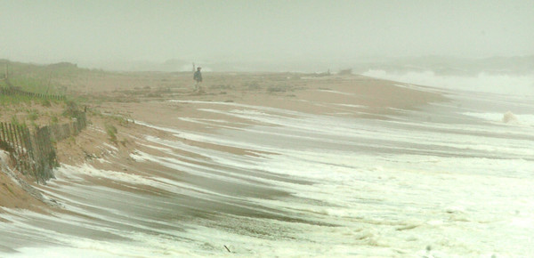 Newbury: A person checks out the wave action on Plum Island in a photo taken from the parking lot at the center looking north. Bryan Eaton/Staff Photo