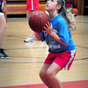 Newburyport: Olivia Oren, 9, practices her foul shots during the Clipper girls basketball camp. Bryan Eaton/Staff Photo