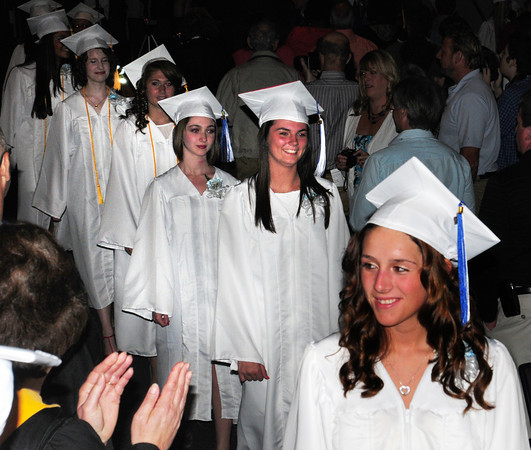 Georgetown: Georgetown seniors march into the auditorium for their graduation ceremony Saturday. Bryan Eaton/Staff Photo