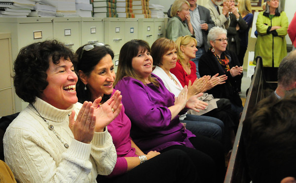Newburyport: Bresnahan School principal Kristina Davis, left, and teachers Joan Notargiacomo and Mary Ellen Hoisieth applause election results last night in favor of rebuilding the school. Bryan Eaton/Staff Photo