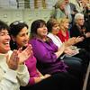 Newburyport: Bresnahan School principal Kristina Davis, left, and teachers Joan Notargiacomo and Mary Ellen Hoisieth applause election results last night in favor of rebuilding the school. Bryan Eaton/Staff Photo