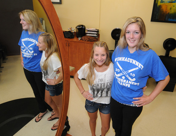 Seabrook:Aeriss Flech, right and  Morgan O'connor pose at Hair Excitement  in Seabrook. The two have been friends most of their lives. they are graduating Friday night and both headed to Plymouth State College next fall. Jim Vaiknoras/staff photo