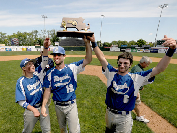 Lowell: Georgetown captains C.J. Ingraham , Ryan Browner, and Mark Berkland hold up the trophy after the Royal's 5-2 victory over Northeast Metro in the Div 4 North Secional Championship at LeLacheur in Lowell Saturday. Jim Vaiknoras/staff photo