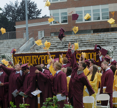Newburyport: Students toss their caps in celebration at the Newburyport High Graduation Ceremony at War Memorial Stadium  Sunday. jim Vaiknoras/staff photoa