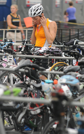 Amesbury:  Ann Hammer transition to her bike at the Dam Triathlon Saturday at Lake Gardner in Amesbury. Jim Vaiknoras/staff photo