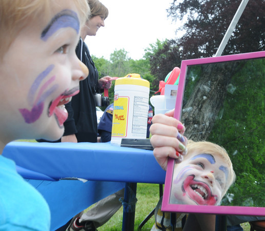 Byfield: August Ames, 2, reacts with a smile after he had his face painted as a clown by Molly Fargoose during Byfield Days Saturday. Jim Vaiknoras/staff photo