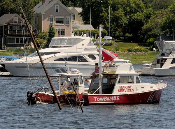 Newburyport: TowBoat/US responds to a sunken wooden sailboat off the Newburyport waterfront Sunday morning. JIm Vaiknoras/staff photo