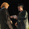 West Newbury: John Qunincy Adams recieves his diploma from School Commitee Chair Christine Reading at the Pentucket Commencement Saturday.Jim Vaiknoras/staff photo. Jim Vaiknoras/staff photo