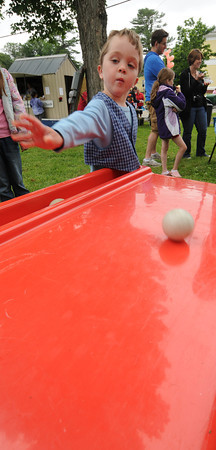 Byfield: Tommy Kenedy, 5, tries his luck at skeeball during Byfield Days Saturday. Jim Vaiknoras/staff photo